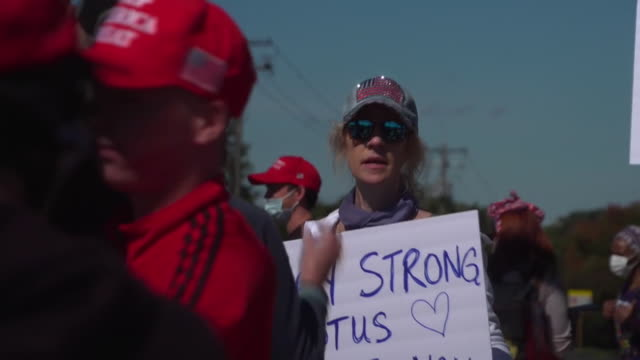 president trump supporters outside walter reed medical center where he is being treated for coronavirus - politics stock videos & royalty-free footage