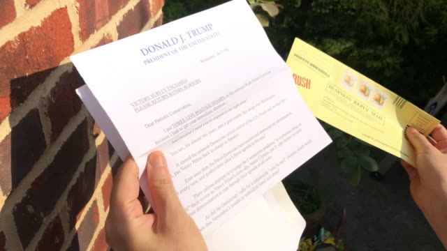 president trump's letter to citizens in the us before the 2020 election amid the global coronavirus pandemic, urging people to register - stay at home mother stock videos & royalty-free footage