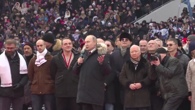 President Vladimir Putin promises victories for Russia at a star studded rally attended by tens of thousands of supporters ahead of a March 18...