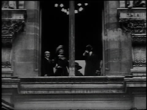 president wilson and mrs. wilson waving from window, joined by general pershing / paris, france - 1918 stock videos & royalty-free footage