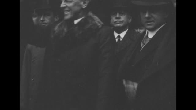 president woodrow wilson and dignitaries walking, he smiles and lifts top hat / wilson and others getting into car backseat on way to address... - top hat stock videos & royalty-free footage