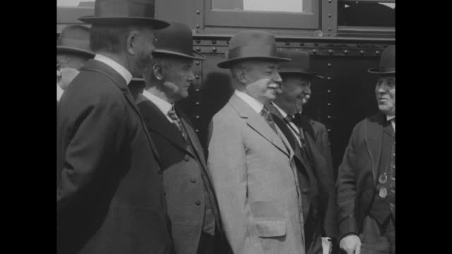 President Woodrow Wilson and members of his cabinet getting off Safety First train after inspecting it / cabinet members standing beside train...