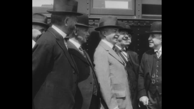 stockvideo's en b-roll-footage met president woodrow wilson disembarks from safety first train and walks, followed by others, during his inspection of the train / slow pan group of... - stoomtrein