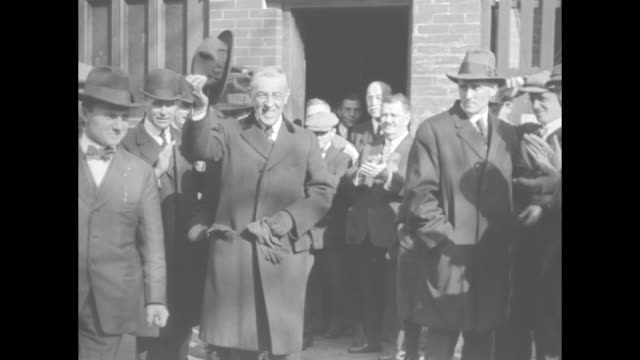 ms president woodrow wilson flanked by secret service walks to polls / mls wilson greeted by friends on way into polls / ms wilson exits polls tips... - voting rights stock videos & royalty-free footage