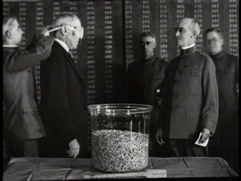 President Woodrow Wilson picks a number from jar for the draft while blindfolded