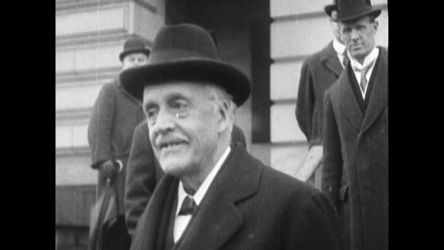 stockvideo's en b-roll-footage met president woodrow wilson smiling taking off top hat standing next to first lady edith - woodrow wilson