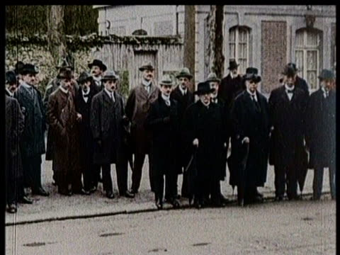 stockvideo's en b-roll-footage met president woodrow wilson speaks at a podium / a group of men stand together on a sidewalk / pages from a book are turned/ - woodrow wilson