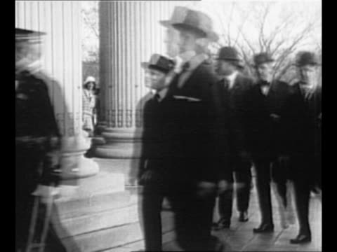 stockvideo's en b-roll-footage met us president woodrow wilson walks on grounds of us capitol / montage wwi battle explosions french soldiers firing from trench artillery fires... - hogehoed