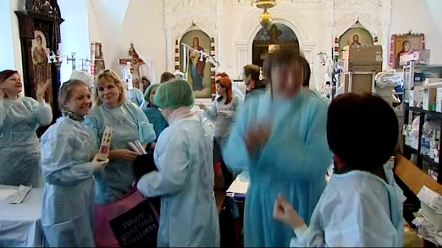 President Yanukovich and opposition leaders sign agreement to end political crisis GV Volunteer nurses in improvised field hospital cheering and...