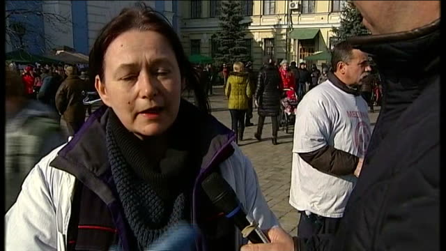 President Yanukovich and opposition leaders sign agreement to end political crisis Kiev EXT Barricade PAN St Michael's GoldenDomed Monastery Women...