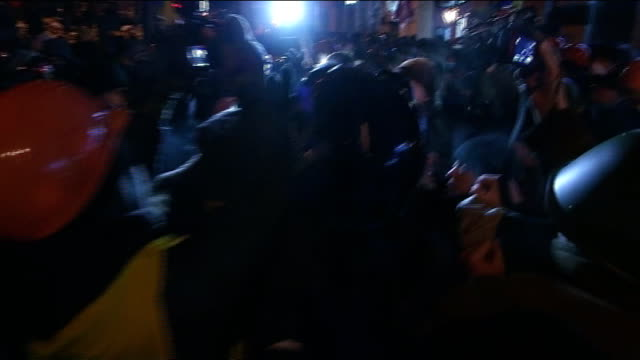 President Yanukovich calls emergency session of parliament NIGHT Vitali Klitschko through press and crowd Demonstrators gathered around lit brazier...