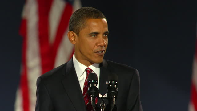 president-elect barack obama addresses the crowd in grant park after winning the 2008 election, becoming the first african american president of the... - グラントパーク点の映像素材/bロール
