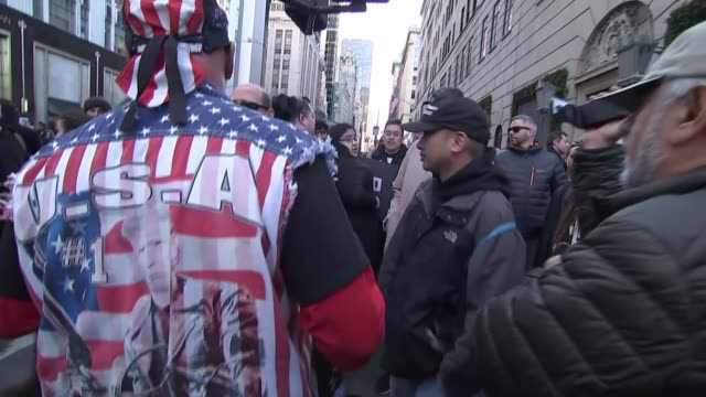 US Presidentelect Donald Trump meets Nigel Farage / Trump '60 Minutes' interview EXT Various shots of protesters marching along and chanting 'pay...