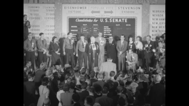 stockvideo's en b-roll-footage met presidentelect dwight eisenhower speaks at microphone in front of election return board thanks staff who are onstage with him / young women... - republikeinse partij vs