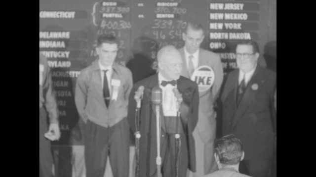 presidentelect dwight eisenhower staff onstage behind him speaks at microphone in front of election return board in republican party hq in commodore... - 1952 stock videos and b-roll footage