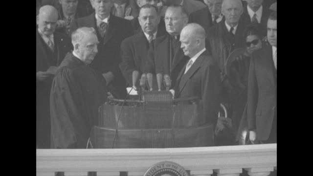 Presidentelect Dwight Eisenhower standing at podium on east portico of US Capitol Vice Presidentelect Richard Nixon standing to his left other...