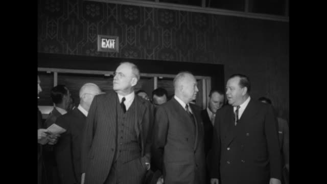 president-elect dwight eisenhower with john foster dulles and recently resigned un secretary general trygve lie in front of doors with exit sign... - us president stock videos & royalty-free footage