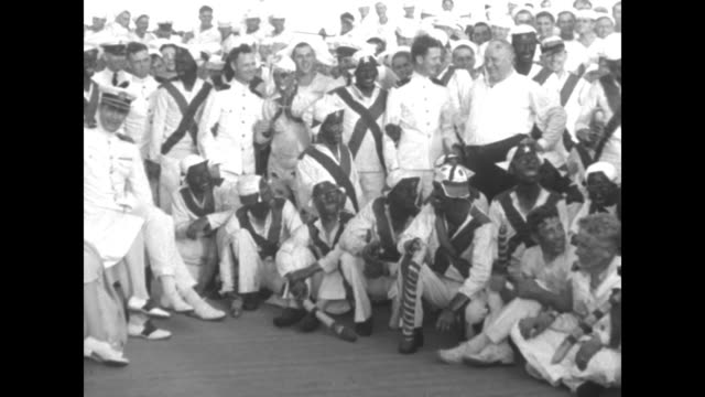 us presidentelect herbert hoover wife lou at right with group of sailors and several in blackface / man dressed as pirate reads from document... - herbert hoover us president stock videos & royalty-free footage
