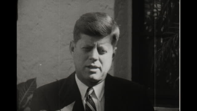 vídeos de stock, filmes e b-roll de presidentelect kennedy with nominee for postmaster general kennedy jokes that it took a letter eight days to get from washington to massachusetts - nomeação