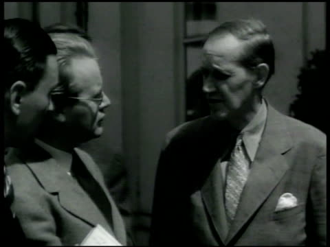 presidential advisor harry hopkins talking w/ newspaper men outside white house. ext social security building. head of war production board donald m.... - 1942 stock videos & royalty-free footage