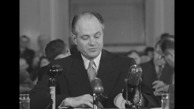 vídeos de stock, filmes e b-roll de presidential aide donald dawson sitting at table in front of microphones testifying before us senate subcommittee - equipamento de mídia