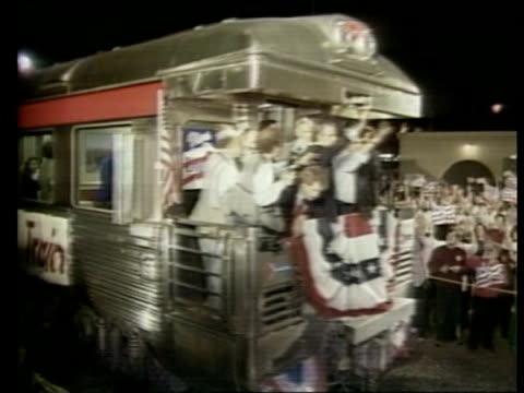 presidential campaign / campaigning california modesto night tms crowd line tracks as campaign train arrives rl ms dukakis standing on rear platform... - francis crick stock videos & royalty-free footage
