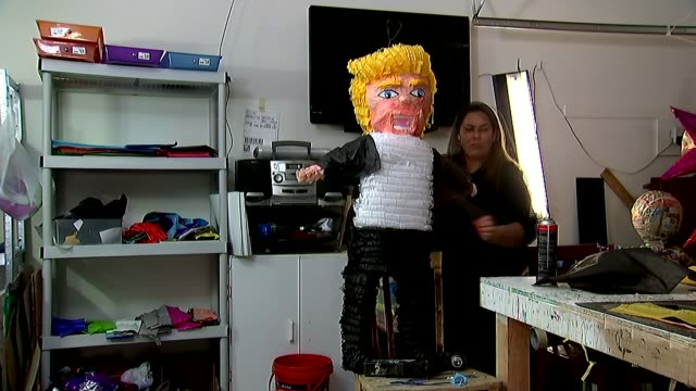 presidential campaign: donald trump trip to mexico; usa: int speeded up sequence - timelapse woman artist making 'donald trump' pinata model/... - papier stock videos & royalty-free footage