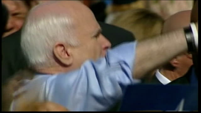 presidential campaign: john mccain questions obama's foreign policy credentials; ext mccain greeting supporters wearing wrist band - john mccain stock videos & royalty-free footage