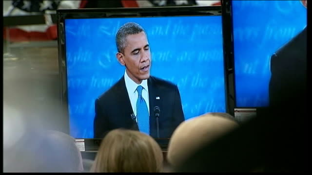 mitt romney 'wins' first television debate obama on television screen in press room high angle view of press room with obama on television screens... - debate stock videos & royalty-free footage