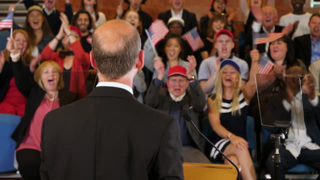 vídeos de stock e filmes b-roll de 4k: usa presidential campaign rally - election candidate speaks to supporters in auditorium - politician