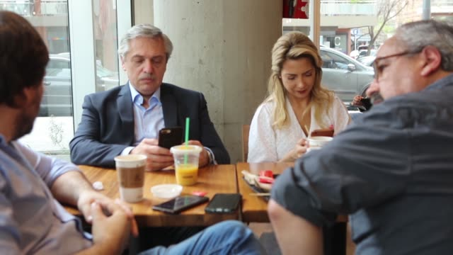 presidential candidate alberto fernandez of 'frente de todos' takes breakfast with his partner fabiola yañez and friends at a starbucks coffee shop... - puerto madero stock videos & royalty-free footage