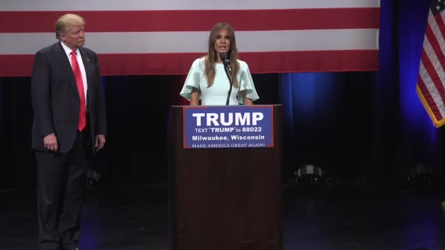 US Presidential candidate and businessman Donald Trump watches as his wife Melania Trump speaks to a crowd in Milwaukee Wisconsin