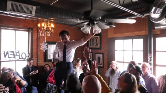 us presidential candidate and south bend indiana mayor pete buttigieg turns off a ceiling fan in davenport ia during a campaign rally - ceiling fan stock videos & royalty-free footage