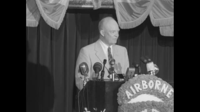 presidential candidate gen. dwight eisenhower stands at lectern at reunion luncheon of the 82nd airborne division, held at the sherman house hotel in... - 弱い点の映像素材/bロール