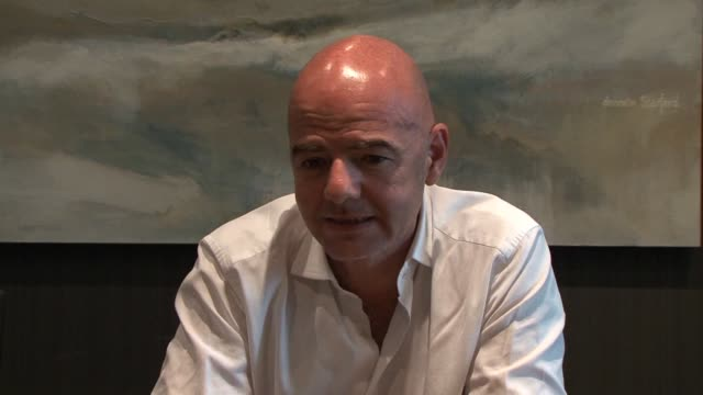 vídeos de stock, filmes e b-roll de fifa presidential candidate gianni infantino gave a press conference on monday ahead of friday's vote to replace sepp blatter who was suspended due... - gianni infantino
