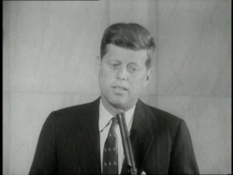 presidential candidate jfk giving a speech about his feelings concerning importance of religion in front of press room / united states - john f. kennedy politik stock-videos und b-roll-filmmaterial