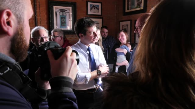 US Presidential candidate Pete Buttigieg meets and shakes hands with voters in Iowa one year ahead of the Iowa caucus