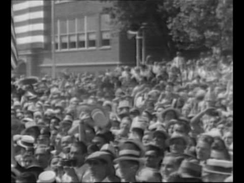 gop presidential candidate wendell willkie stands on train platform shakes hands with members of crowd as he campaigns in his hometown of elwood in... - hometown stock videos and b-roll footage