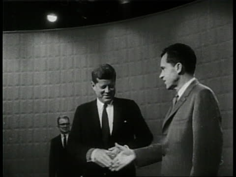 presidential candidates senator john f kennedy and senator richard nixon shake hands before a televised debate - debatte stock-videos und b-roll-filmmaterial