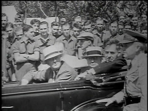 presidential caravan arrives in camp / roosevelt speaks to uniformed man / roosevelt seated speaking and smiling - civilian conservation corps stock videos & royalty-free footage
