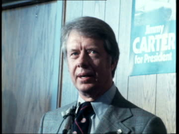 presidential election 1976: jimmy carter campaigns; usa: wisconsin: madison: ext jimmy carter bounds down plane steps walks to bv greets peopel int... - president stock videos & royalty-free footage