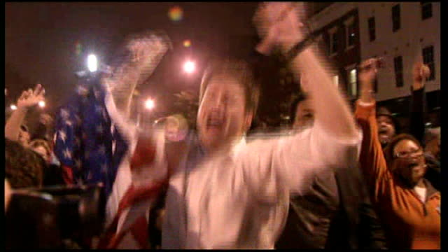 barack obama victory us reaction ext people out on streets celebrating barack obama victory chanting 'usa' and 'obama' sot and couple embracing - election stock videos & royalty-free footage