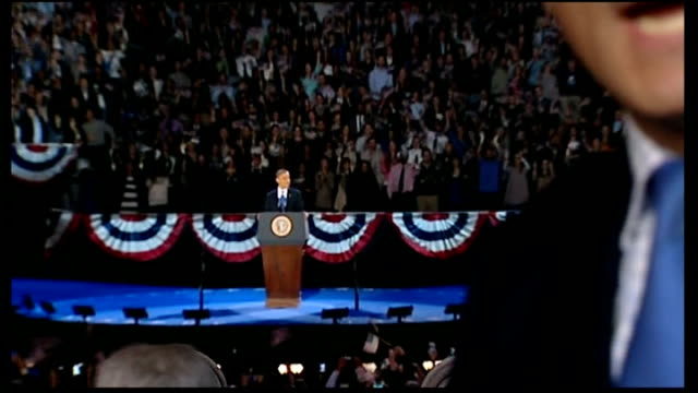 barack obama wins second term obama on stage pull out reporter to camera flags waving at victory rally woman cheering more of flag waving - 2012 united states presidential election stock videos & royalty-free footage