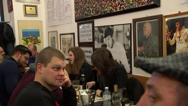 Presidential election campaign dominated by immigration debate ITALY Milan Ristorante Da Oscar INT Various of brass band in restaurant playing...