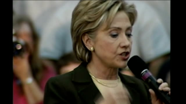 stockvideo's en b-roll-footage met iowa caucuses underway usa iowa des moines int *** beware hillary clinton speaking on stage as addressing campaign rally sot crowd cheering and... - geheime dienstagent