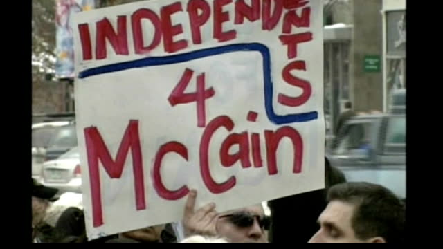 vídeos de stock, filmes e b-roll de new hampshire primary voting ext john mccain shaking hands with supporters poster 'independents 4 mccain' mccain addressing supporters rival... - primary election