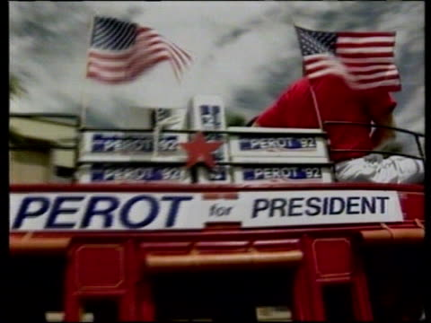 presidential election campaign: ross perot name still on ballot papers; usa: arizona: ext lams stagecoach with us flags and ross perot election... - 米国大統領選挙点の映像素材/bロール