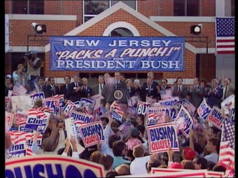 stockvideo's en b-roll-footage met presidential election campaign; us pool usa: ext pres bush on platform at rally cms pres george bush speaking at rally sof - clinton wants more... - politics and government