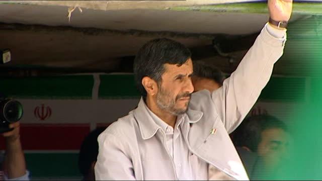 Presidential election campaigning LIB Tehran EXT Mahmoud Ahmadinejad waving at crowd at rally Crowd waving flags Ahmadinejad waving