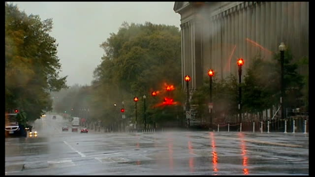 presidential election campaigning put on hold due to hurricane sandy washington american flag flying on flagpole outside capitol building gv deserted... - 2012 united states presidential election stock videos & royalty-free footage
